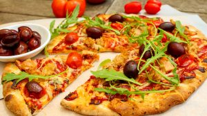 Tuna olive rocket pizza